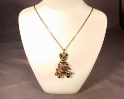 A Large 9ct Rabbit pendant with sapphires and diamond