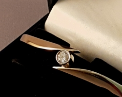 A Gorgeous 14ct Gold Bangle with.50ct diamond